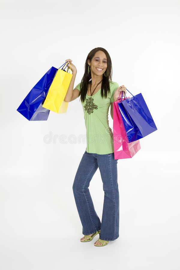 Shopping. Young African American woman shopping stock photography