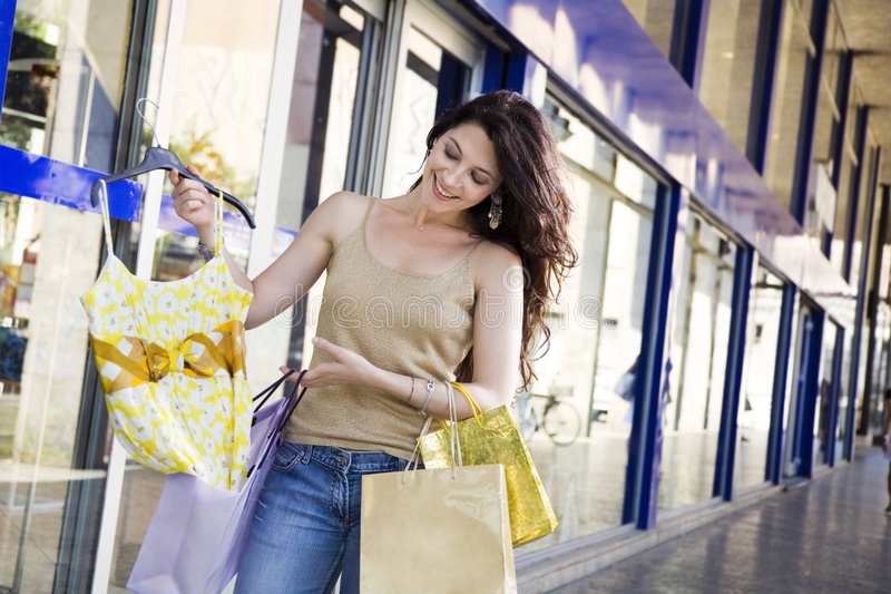 Shopping. Mid adult Italian woman holding shopping bags royalty free stock photos
