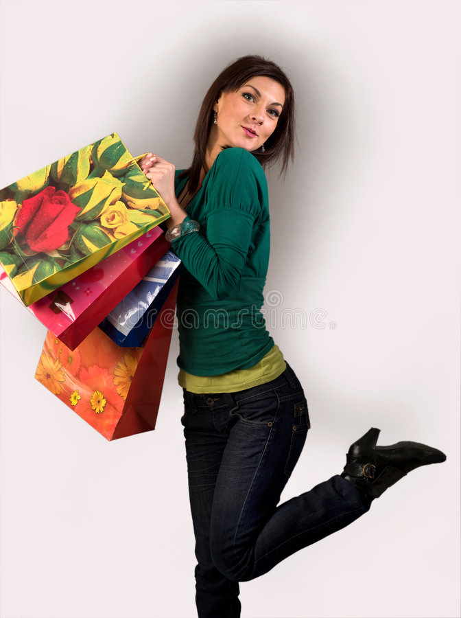 Shopping. A girl that was shopping royalty free stock image