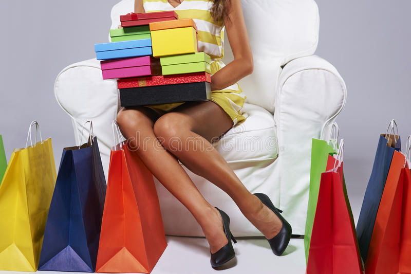 Shopping. Abundance of shopping bags around the woman royalty free stock images
