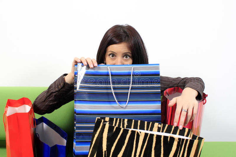 Shopping addiction. Shopping addict woman with lots of bags