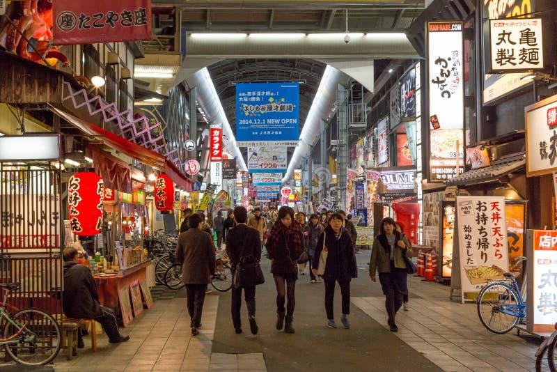 Shopping arcade in Dotonbori district in Osaka, Japan. Osaka, Japan - December 09, 2014: People in the covered shopping arcade in Dotonbori district royalty free stock photos