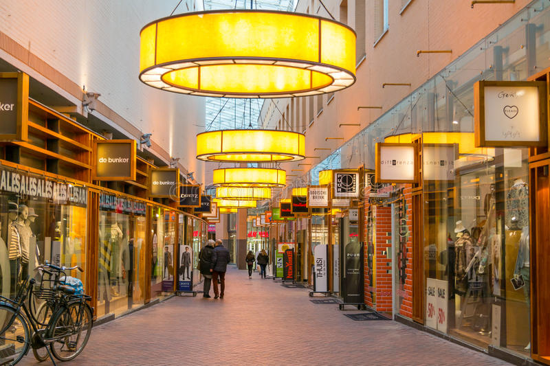 Shopping arcade in Hilversum, Netherlands. People walking in shopping arcade Gooische Brink in downtown Hilversum, Netherlands stock photo