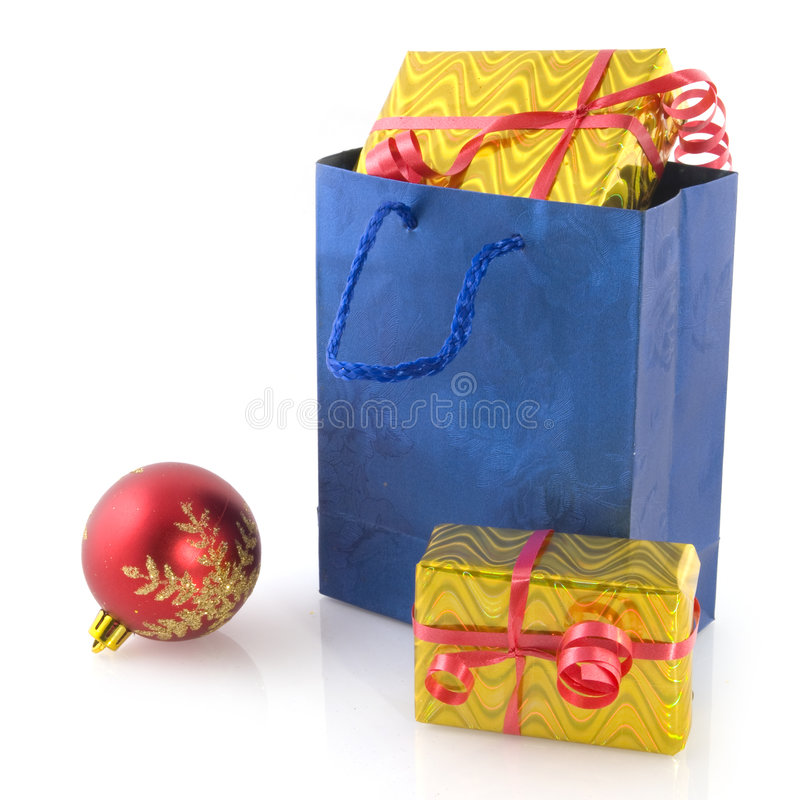 Shopping bag with christmas presents royalty free stock photography