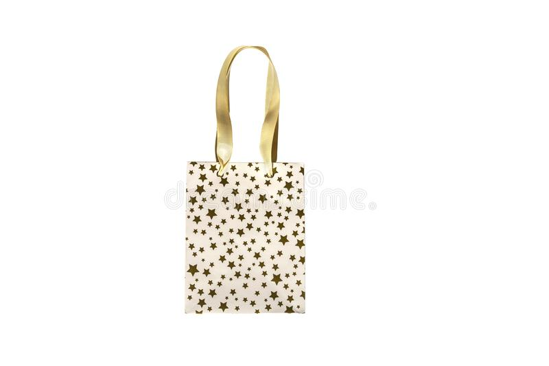 Shopping bag, gift box in modern style on white background. Golden stars - fashion modern design. Minimal concept. Flat lay, top royalty free stock images