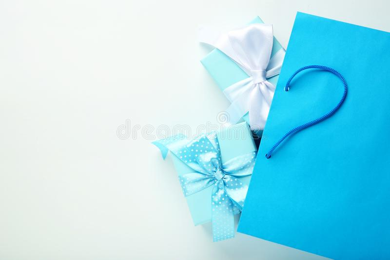 Shopping bag with gift boxes stock image