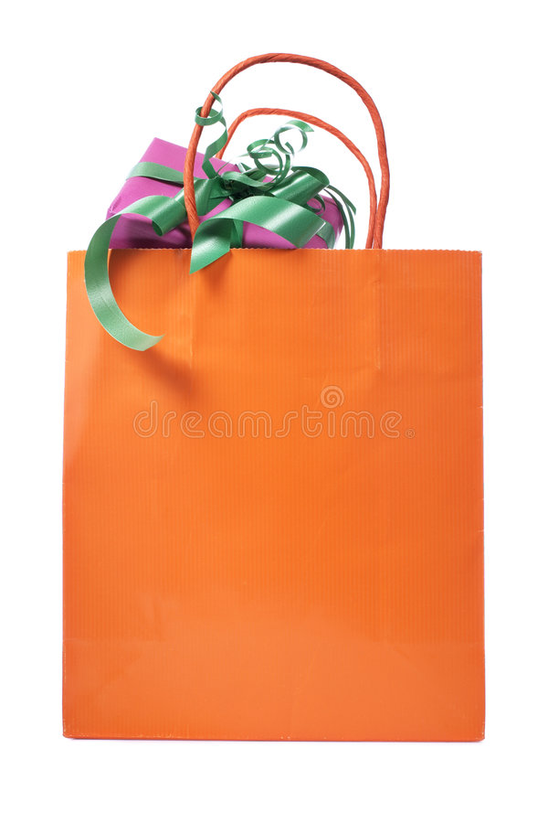 Shopping bag with gifts inside stock photo