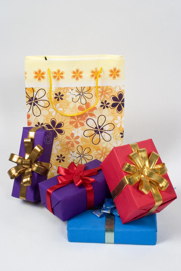 Shopping bag with wrapped gifts. Shopping bag with lots of wrapped gifts, isolated royalty free stock photos