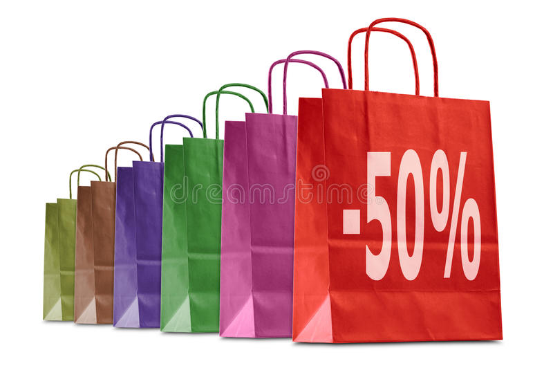 Shopping bags. Discount shopping bags with different colors, isolated on white stock images