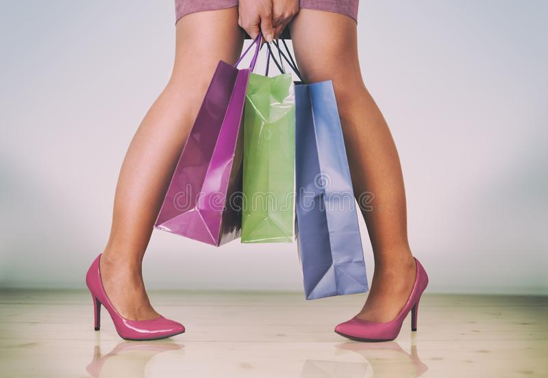 nice woman legs with shopping bags in her hands stock image