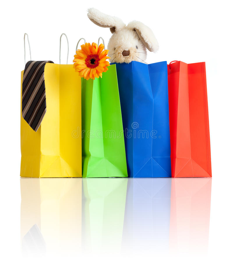 Shopping bags with purchases for family on white stock photos