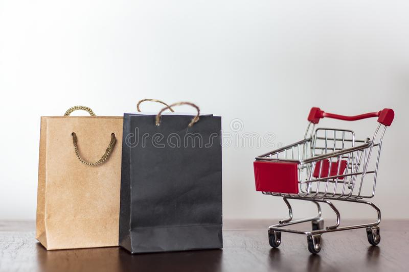 Shopping bags and shopping cart stock images