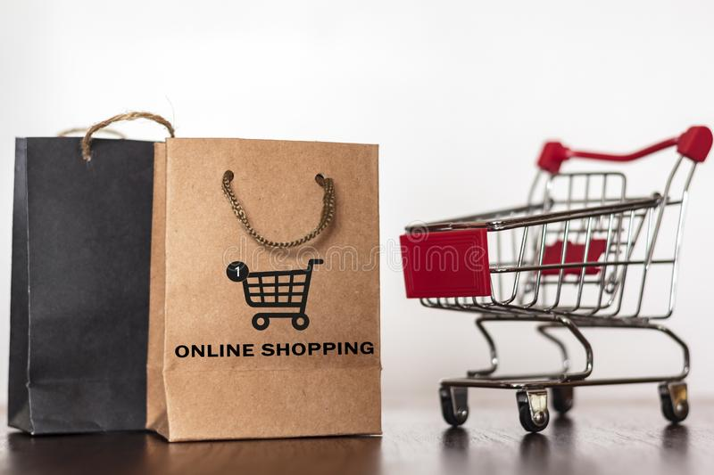 Shopping bags and shopping trolley. Commercial business, e-commerce, online shopping concept.  royalty free stock images