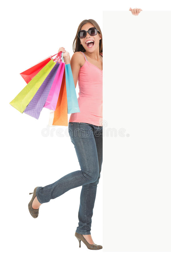 Shopping bags woman showing advertisement sign royalty free stock photos