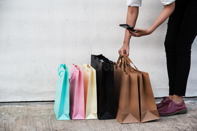 Shopping bags of women crazy shopaholic lady put on cement ground floor royalty free stock photography