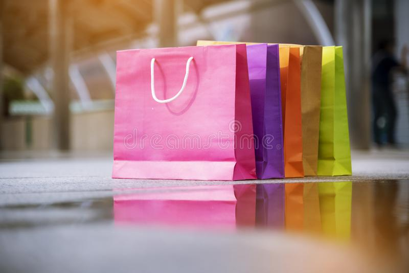 Shopping bags of women crazy shopaholic person at shopping mall indoor. Fashionable Woman love online website with sales tag on stock photography