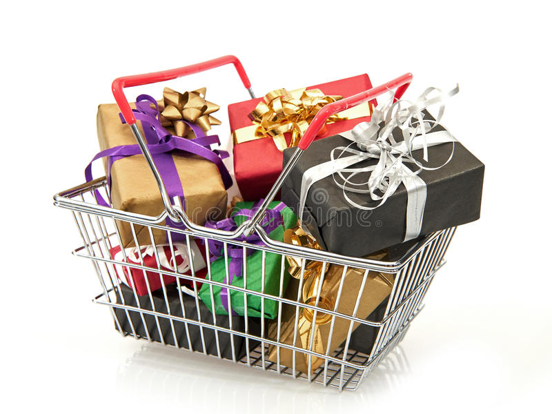 Shopping basket filled with christmas presents royalty free stock photo