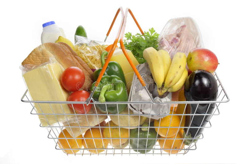Shopping basket filled with groceries. royalty free stock images