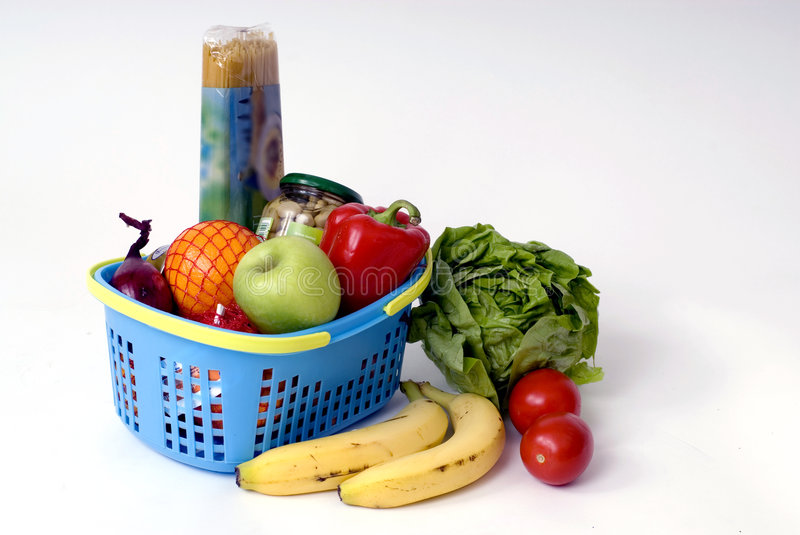 Shopping-basket with food. Shopping-basket filled with food and fruit royalty free stock photo