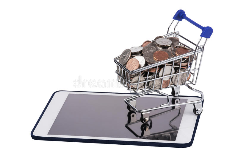 Shopping basket full of US coins on a tablet pc isolated on a white background royalty free stock images