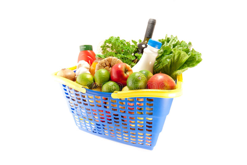 Shopping basket with groceries royalty free stock images