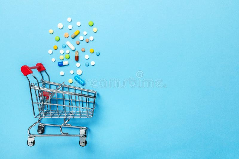 Shopping basket and pills. The concept of buying drugs online, delivery of medical devices. Copy space for text. stock images