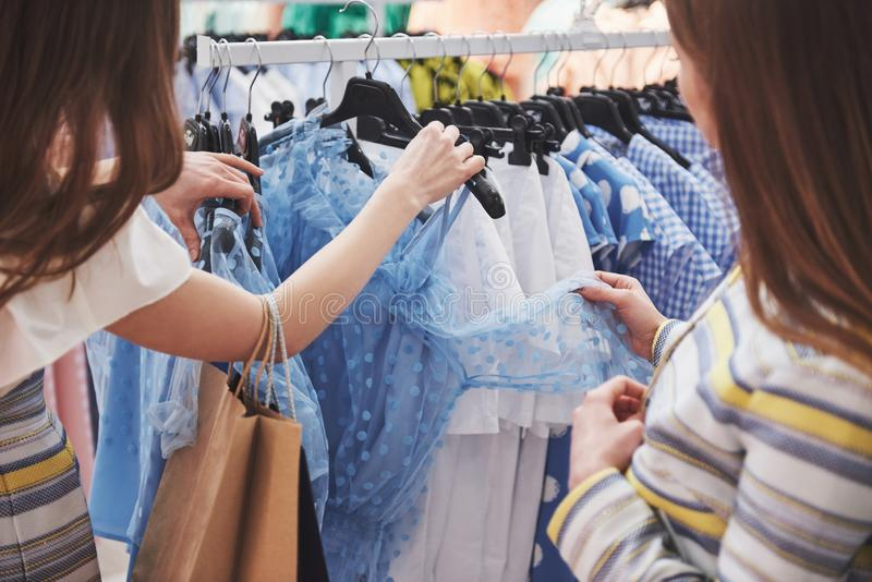Shopping with bestie. two women shopping in retail store. Close up view royalty free stock photos