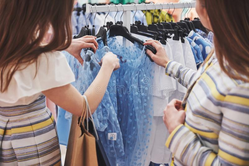 Shopping with bestie. two women shopping in retail store. Close up view royalty free stock photo