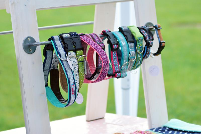 Shopping booth with self made dog collars on wooden display at animal fair royalty free stock image