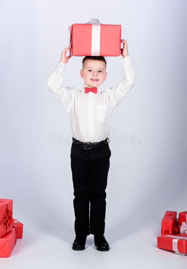 Shopping. Boxing day. New year. Birthday party. tuxedo style. Happy childhood. little boy with valentines day gift. Happy child with present box. Christmas royalty free stock photography