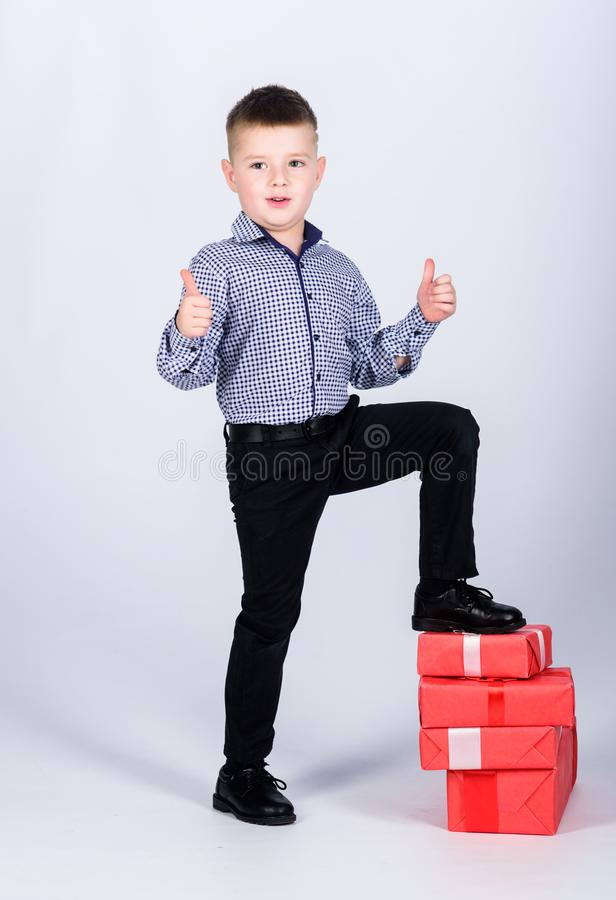Shopping. Boxing day. New year. happy child with present box. Christmas. Birthday party. little boy with valentines day. Gift. shop assistant. Happy childhood royalty free stock image