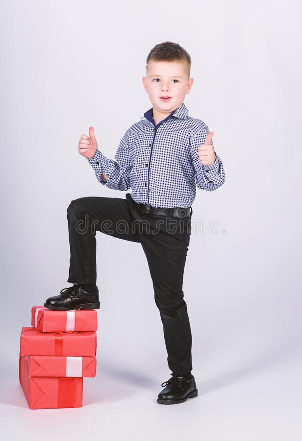 Shopping. Boxing day. New year. happy child with present box. Christmas. Birthday party. little boy with valentines day. Gift. shop assistant. Happy childhood royalty free stock photos