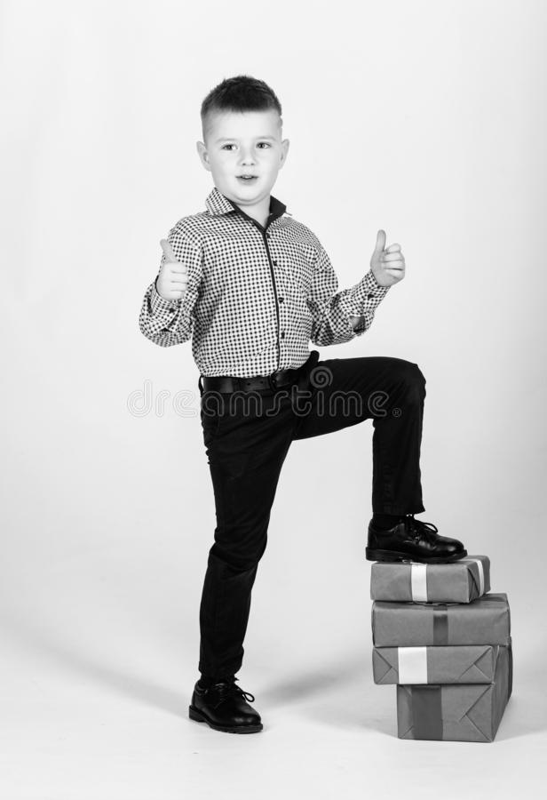 Shopping. Boxing day. New year. happy child with present box. Christmas. Birthday party. little boy with valentines day. Gift. shop assistant. Happy childhood royalty free stock images