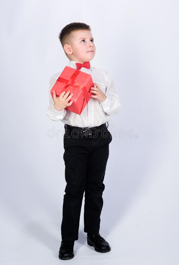 Shopping. Boxing day. New year. little boy with valentines day gift. Birthday party. tuxedo style. Happy childhood. Happy child with present box. Christmas stock photography