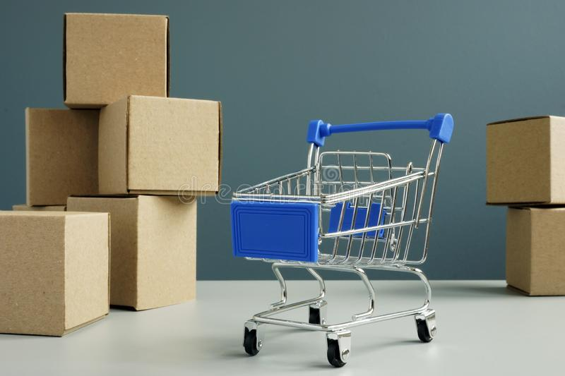 Shopping card and cardboard boxes. Online shopping and delivery. Concept stock images