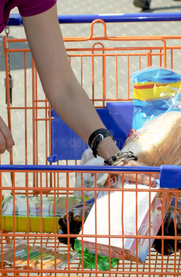 Shopping cart. A shopping cart full with products royalty free stock photography