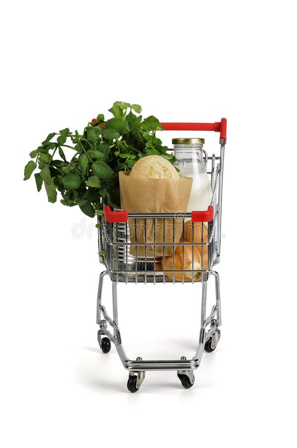 Shopping cart. Full with groceries isolated in white royalty free stock photography