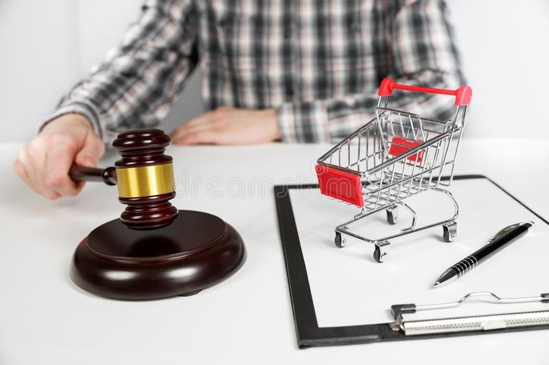 Shopping cart and auction hammer stock photos