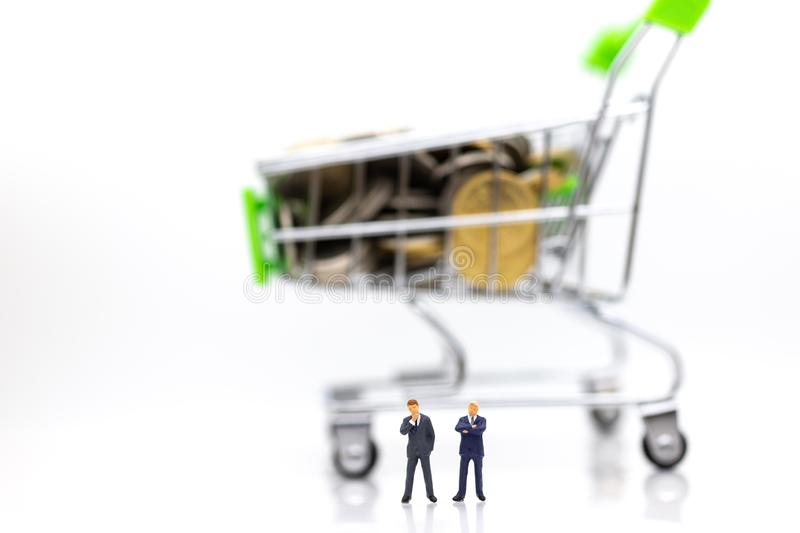 Shopping cart with box inside for retail business. Image use for online and offline shopping, marketing place world wide.  stock photography