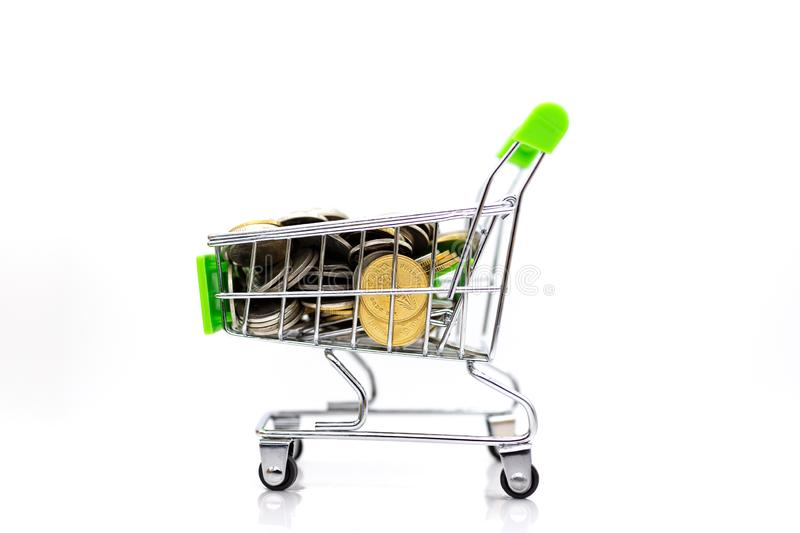 Shopping cart with box inside for retail business. Image use for online and offline shopping, marketing place world wide.  royalty free stock photography