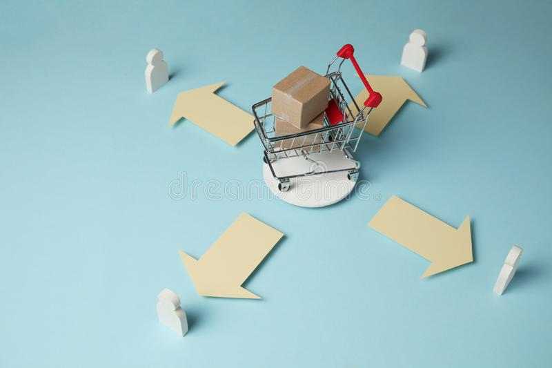 Shopping cart with boxes. Purchase and delivery of goods boxes from online stores, retail.  royalty free stock photos