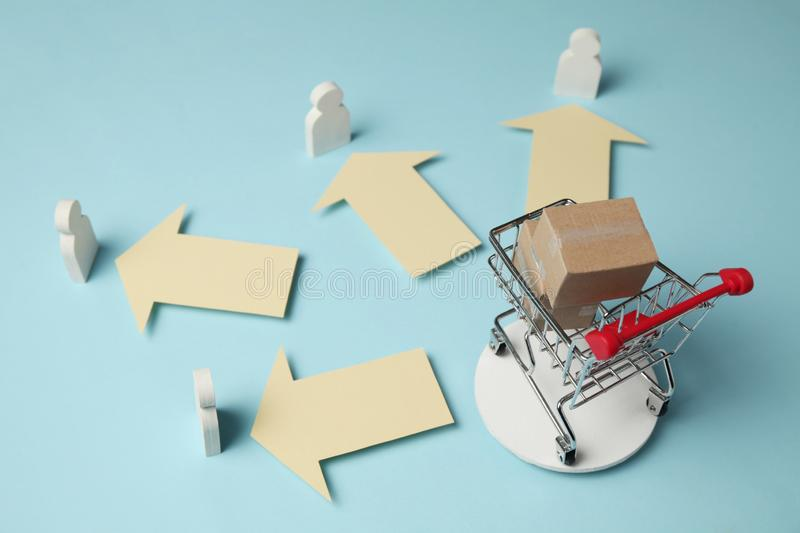 Shopping cart with boxes. Purchase and delivery of goods boxes from online stores, retail.  royalty free stock photography