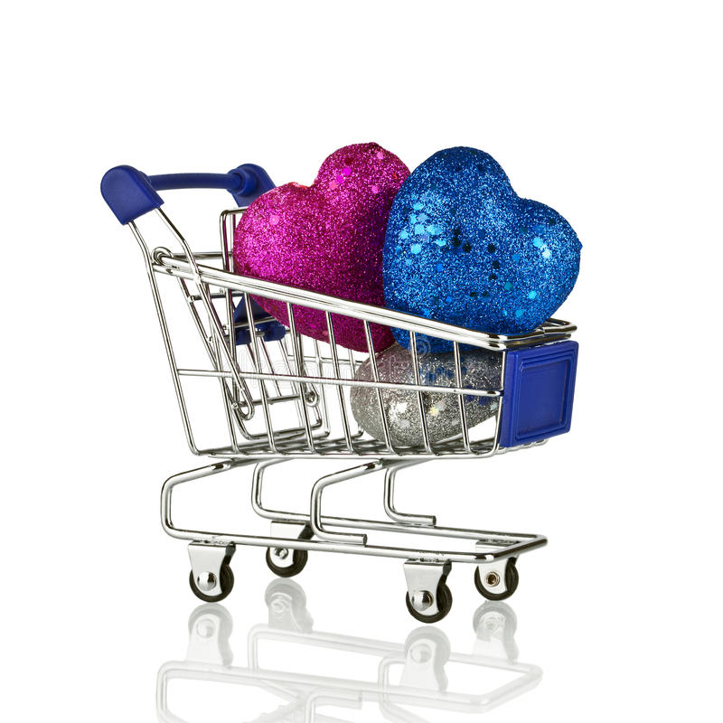 Shopping cart with Christmas gifts and presents. Concept royalty free stock image