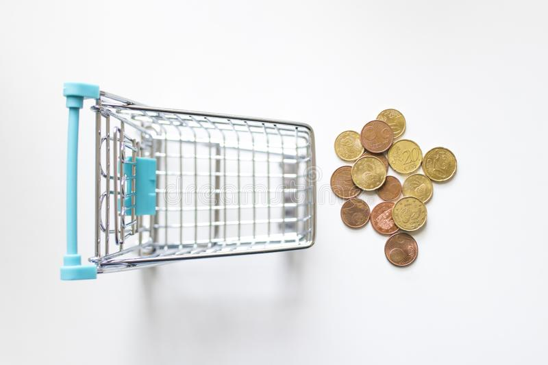 Shopping cart with coins. In white background stock images