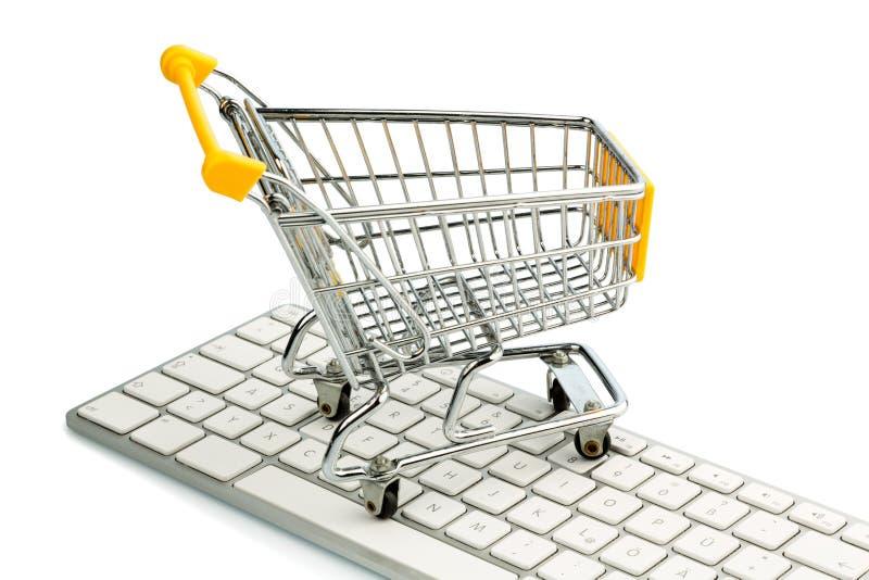 Shopping cart and computer keyboard stock photos