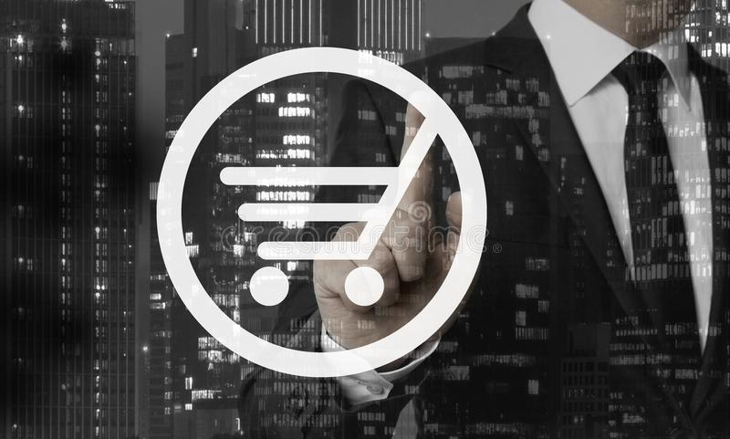 Shopping cart concept is shown by businessman royalty free stock photo