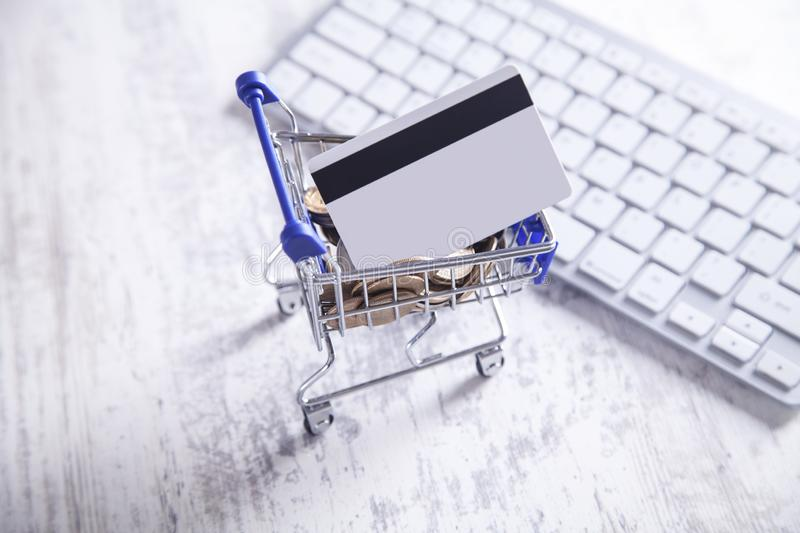 Shopping cart with credit card and keyboard royalty free stock photos