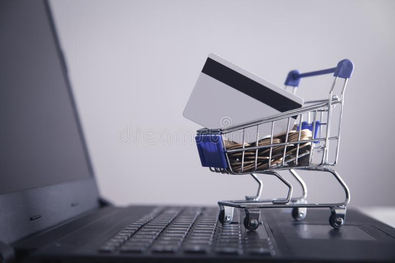 Shopping cart and credit card with laptop royalty free stock photos