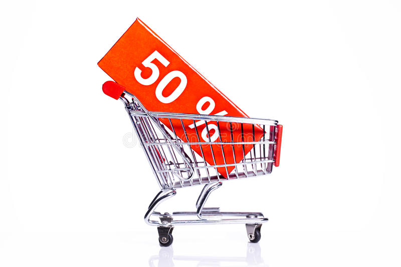 Shopping cart with 50% discount icon. Shopping carts with sales icons isolated on white royalty free stock images