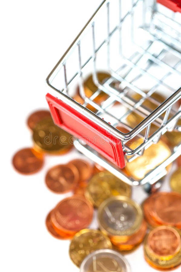 A shopping cart with euro coins stock photo